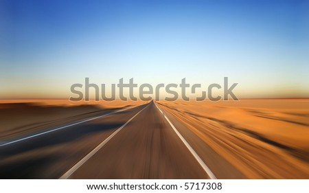 Fast Driving on Desert Highway - stock photo