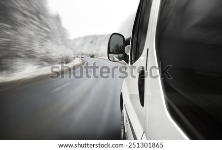Fast driving on the road - stock photo