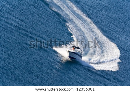 fast driving yacht on the ocean - stock photo