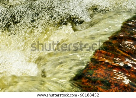 Fast flowing water in the mountain river - stock photo