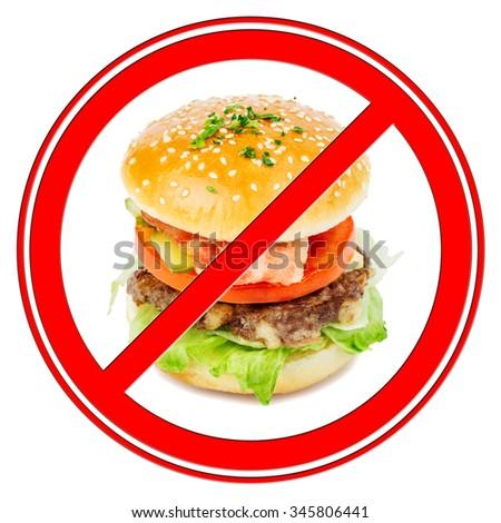 fast food and unhealthy eating concept - close up of burger or cheeseburger behind no symbol or circle-backslash prohibition sign - stock photo