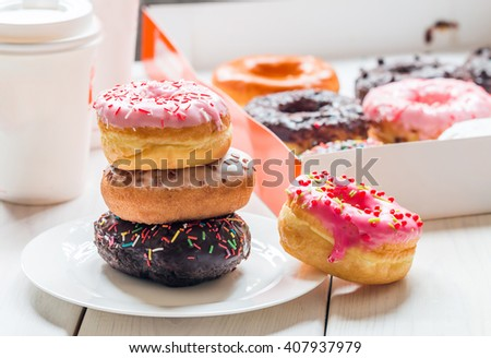 Fast food breakfast with donut and coffee - stock photo