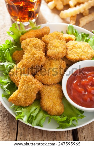 fast food chicken nuggets with ketchup, french fries, cola - stock photo