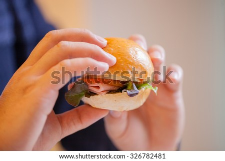 Fast food concept. Tasty  burger sandwich  in hands  - stock photo