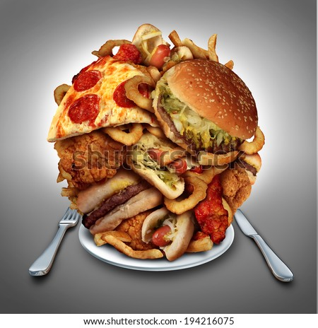 Fast food diet concept served on a plate of greasy fried take out as onion rings burger and hot dogs with fried chicken french fries and pizza as a symbol of compulsive overeating and dieting. - stock photo