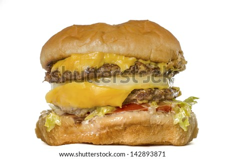 Fast food double burger isolated against white background - stock photo