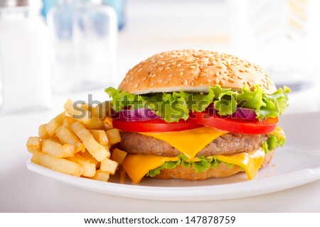 Fast food eat. Burger and French Fries on the plate. - stock photo