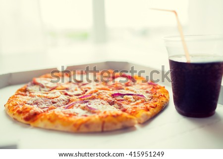 fast food, italian kitchen and eating concept - close up of pizza in paper box with cup of cola drink on table - stock photo