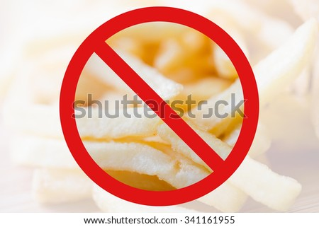 fast food, low carb diet, fattening and unhealthy eating concept - close up of french fries behind no symbol or circle-backslash prohibition sign - stock photo