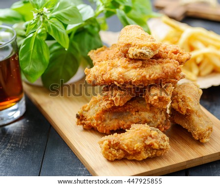 Fast Food Set - Fried Chicken and French Fries on Wooden Background.