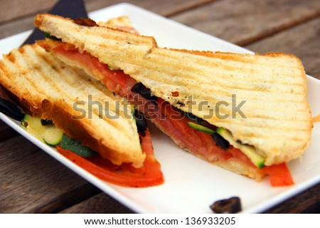 Fast food, toast sandwich with ham and vegetables/Toast with ham - stock photo