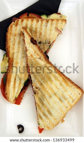 Fast food, toast sandwich with ham and vegetables/Toasted sandwich - stock photo