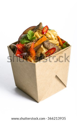 fast food with meat and mushrooms in a box on a white background