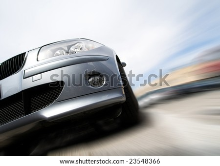 Fast generic vehicle with no logo moving with motion blur - stock photo