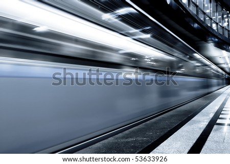 fast gray moving train by motion - stock photo