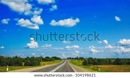 fast highway in forest under clean blue sky - stock photo