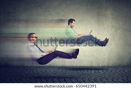 Fast internet concept. Two levitating business men on road using laptop