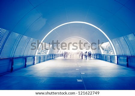 fast life in the City with lot of Business People in underpass - stock photo
