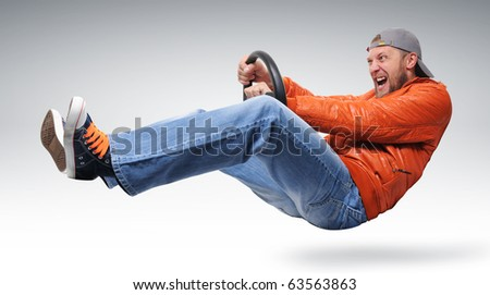 Fast man driver with a wheel in orange jacket, concept - stock photo