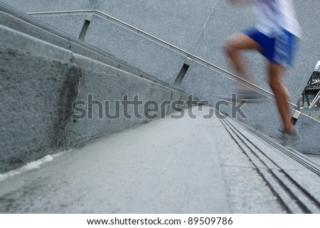Fast Man running up stairs. Conceptual image about speed. - stock photo