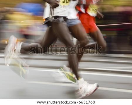fast marathon runners slow sync close up shoot - stock photo