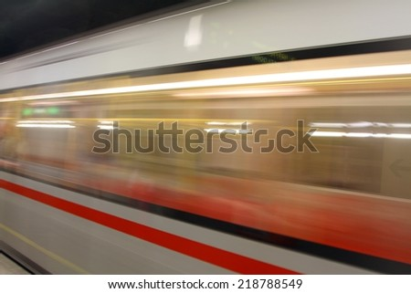 fast Metro wagon while hurtling fast in station - stock photo