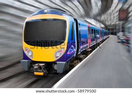 Fast Modern Passenger Commuter Transport Train with Motion Radial Zoom Blur