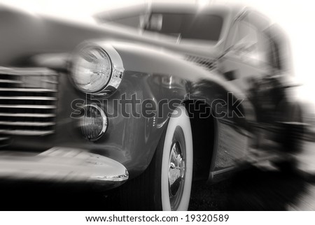 Fast moving antique car with zoom blur - stock photo