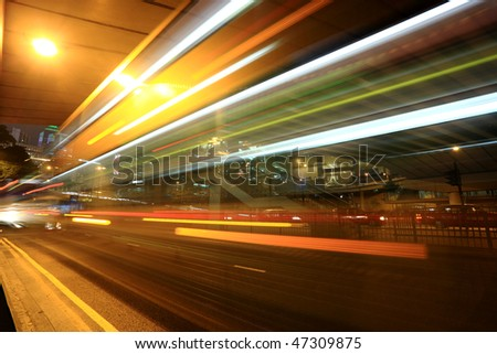 fast moving bus at night in Hong Kong - stock photo
