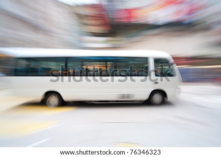Fast moving bus with motion blur effect to show speed of the vehicle - stock photo