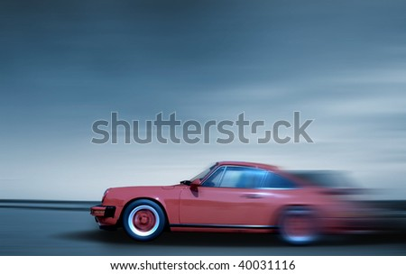 Fast moving car - stock photo