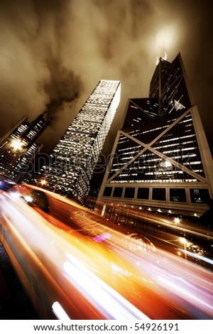 Fast moving car at night - stock photo