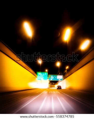 Fast moving cars on highway at night with soft motion blur concept
