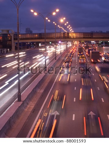 Fast moving color car lights on night highway