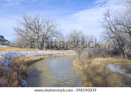 Fast moving dirty river of the Bad Lands - stock photo