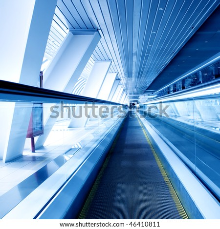 fast moving escalator by motion - stock photo