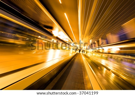 fast moving escalator in motion