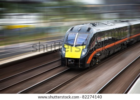 Fast moving modern train - stock photo