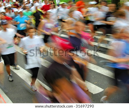 Fast moving runners - motion blur - stock photo