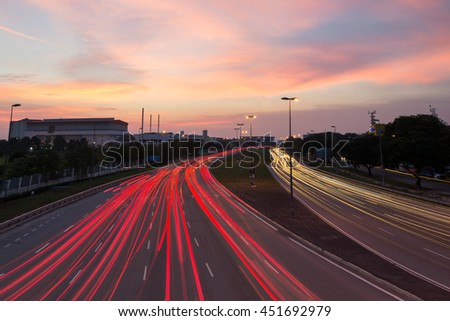 Fast moving traffic light trails during stunning sunset