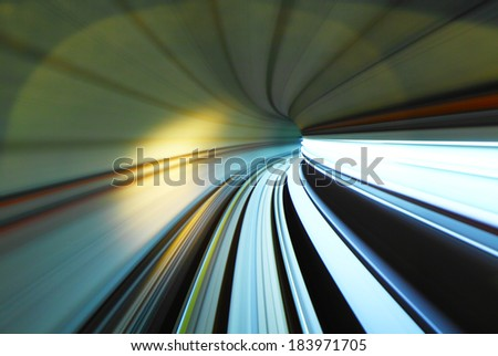 Fast moving train trail in tunnel - stock photo
