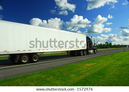 Fast moving truck on highway, blurred because of motion - stock photo