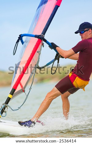 Fast moving windsurfer on the water at Keurbooms Lagoon, South Africa – Movement on windsurfer extremities