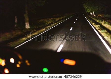 Fast night driving, view from inside of a car
