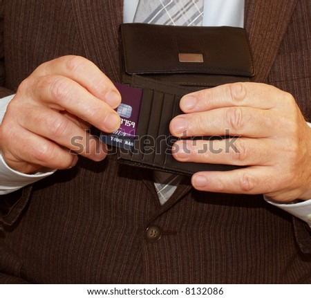 Fast on the drawer businessman opening his wallet - stock photo