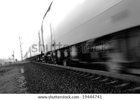 Fast passenger train motion blur. Highkey image - stock photo