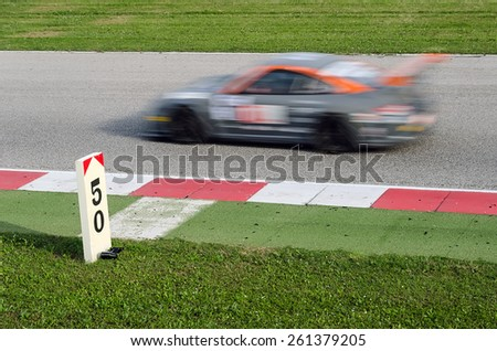 fast racing car over the track - stock photo