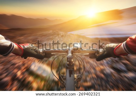Fast ride on bike in mountain valley. Sport and active life concept - stock photo