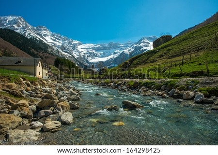 Fast river in Cirque de Gavarnie valley, France - stock photo