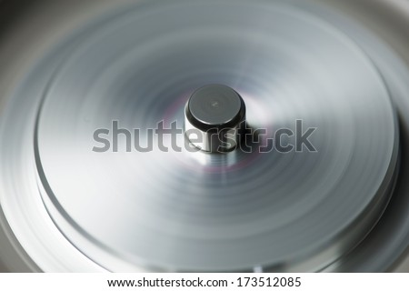 Fast rotating metal mechanism. Rotary head of video recorder or VCR. - stock photo